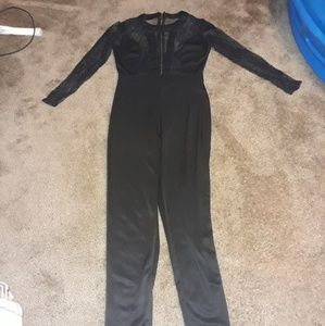 Black jumpsuit with lace at the top